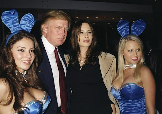 <p>Donald Trump and girlfriend Melania Knauss are joined by a couple of <em>Playboy</em> Bunnies at a launch party for the Hugo Boss store at Fifth Ave. and 56th St. in New York City, circa 2000. (Photo: Richard Corkery/NY Daily News Archive via Getty Images) </p>