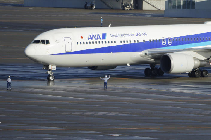 A Japanese chartered plane carrying evacuees from Wuhan, China, landed at Haneda international airport in Tokyo Wednesday, Jan. 29, 2020, in Tokyo. (AP Photo/Eugene Hoshiko)
