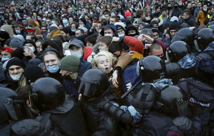 FILE - In this Jan. 23, 2021, file photo, people clash with police during a protest against the jailing of opposition leader Alexei Navalny in St. Petersburg, Russia. Allies of Navalny are calling for new protests next weekend to demand his release, following a wave of demonstrations across the country that brought out tens of thousands in a defiant challenge to President Vladimir Putin. (AP Photo/Dmitri Lovetsky, File)