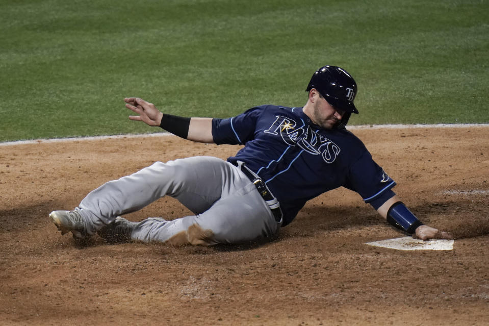 Tampa Bay Rays' Mike Zunino scores on a double by Brett Phillips during the eighth inning of the team's baseball game against the Los Angeles Angels, Thursday, May 6, 2021, in Anaheim, Calif. (AP Photo/Jae C. Hong)
