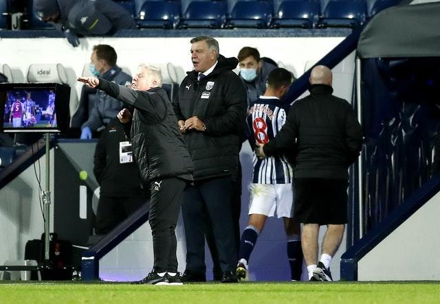 Jake Livermore, second right, is led down the tunnel after being sent off