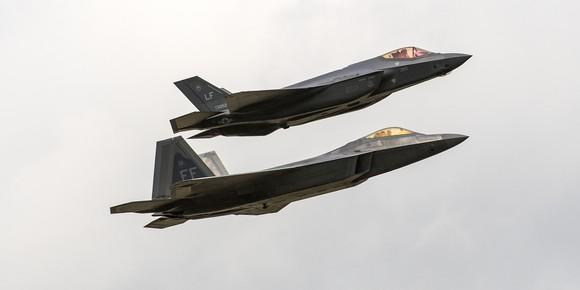 Lockheed Martin-made F-22 and F-35 warplanes together in flight.
