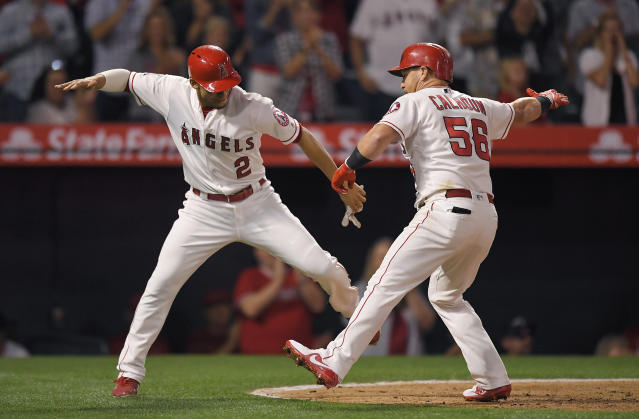 Los Angeles Angels' Kole Calhoun, right, is congratulated by Andrelton Simmons after hitting a two-run home run during the fourth inning of the team's baseball game against the Toronto Blue Jays on Thursday, June 21, 2018, in Anaheim, Calif. (AP Photo/Mark J. Terrill)