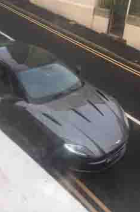 The owner of the £150,000 Aston Martin had left the car parked on double yellow lines. (Reach)
