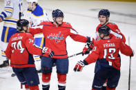 Washington Capitals center Nic Dowd (26) celebrates his goal with defenseman John Carlson (74), left wing Jakub Vrana (13) and right wing Garnet Hathaway (21) during the second period of an NHL hockey game against the Buffalo Sabres, Friday, Jan. 22, 2021, in Washington. (AP Photo/Nick Wass)