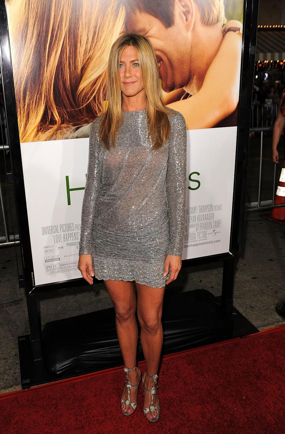 <p>Jennifer donned another metallic minidress – this time in pure silver. <i>[Photo: Getty]</i> </p>
