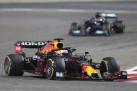 Red Bull driver Max Verstappen of the Netherlands steers his car followed by Mercedes driver Lewis Hamilton of Britain during the Bahrain Formula One Grand Prix at the Bahrain International Circuit in Sakhir, Bahrain, Sunday, March 28, 2021. (AP Photo/Kamran Jebreili)