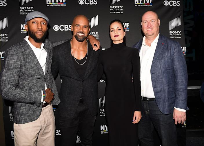 """S.W.A.T."" actors Aaron Rahsaan Thomas (left), Shemar Moore and Lina Esco, and executive producer Shawn Ryan appear at premiere-season event for the CBS police drama in 2017. Thomas is one of the few Black executive producers on a network police show."