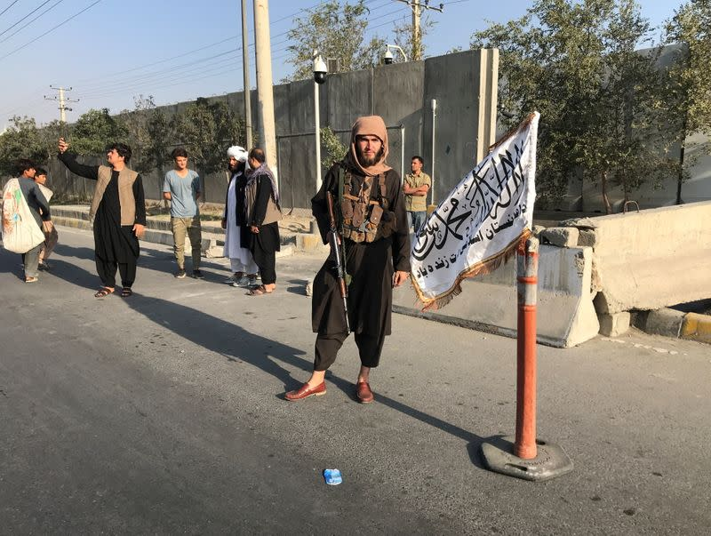 A member of Taliban stands outside the Interior Ministry in Kabul