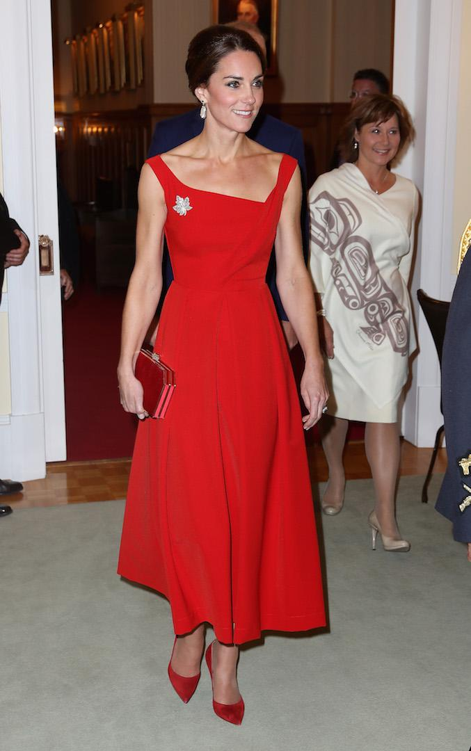 On day three of the Duke and Duchess of Cambridge's Royal Tour of Canada, the royal paid sartorial tribute to the nation during a reception at Government House. Stealing the spotlight, Kate opted for a £1,000 deep red Preen dress with matching accessories (and a maple leaf brooch borrowed from Her Majesty). <em>[Photo: Getty]</em>