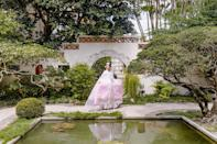 """My jaw dropped when I first saw this part of the garden at the Society of the Four Arts garden in Palm Beach. I felt as if I was transported to a tranquil garden in Asia. Our photographer <a href=""""https://www.instagram.com/sarahfalugo.co/?hl=en"""" rel=""""nofollow noopener"""" target=""""_blank"""" data-ylk=""""slk:Sarah Falugo"""" class=""""link rapid-noclick-resp"""">Sarah Falugo</a> beautifully captured all six layers that made up my hanbok."""