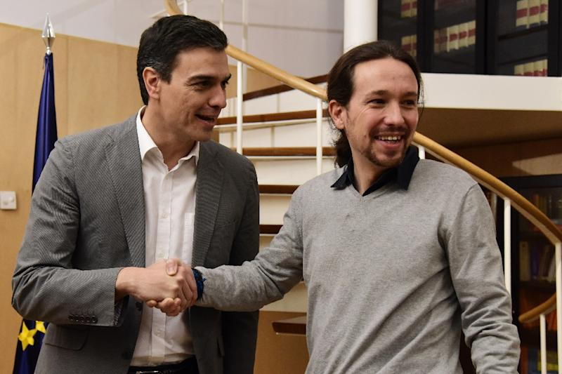 Socialist Party (PSOE) leader Pedro Sanchez (left) shakes hands with his Podemos counterpart Pablo Iglesias before power-sharing talks in Madrid, on February 5, 2016