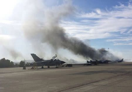 Smoke rises after a Greek F-16 fighter plane crashed during NATO training at the Albacete air base in Albacete, Spain, January 26, 2015.  REUTERS/Cadena Ser