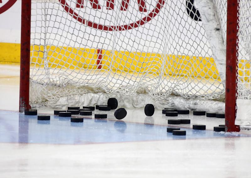 NEW YORK, NY - FEBRUARY 26: Pucks sit in the net prior to the game between the New York Rangers and the Arizona Coyotes at Madison Square Garden on February 26, 2015 in New York City. The Rangers defeated the Coyotes 4-3. (Photo by Bruce Bennett/Getty Images)