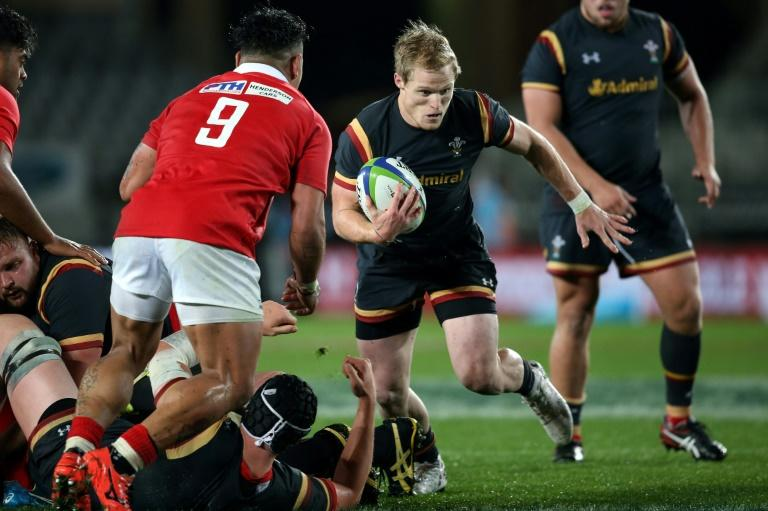 Aled Davies of Wales makes a break during their rugby union Test match against Tonga, at Eden Park in Auckland, on June 16, 2017