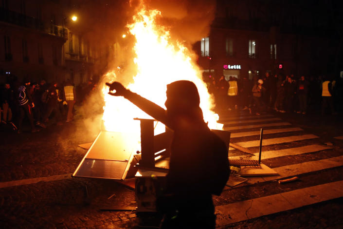 Demonstrators gather around a burning barricade during clashes with riots police, in Paris, France, Saturday, Dec. 8, 2018. (Photo: Thibault Camus/AP)