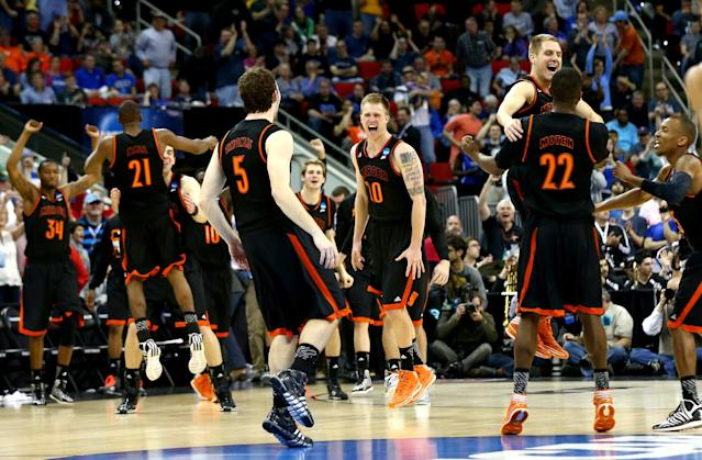 RALEIGH, NC - MARCH 21: Jakob Gollon #20 of the Mercer Bears celebrates with teammates after defeating the Duke Blue Devils 78-71 during the Second Round of the 2014 NCAA Basketball Tournament at PNC Arena on March 21, 2014 in Raleigh, North Carolina. (Photo by Streeter Lecka/Getty Images)
