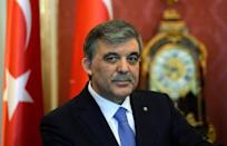 Turkey's President Abdullah Gul (C) gives a statement with his Hungarian counterpart in the presidental palace in Budapest on February 17, 2014 during their joint press conference
