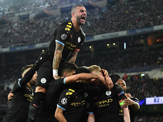 Manchester City celebrate after Kevin De Bruyne's penalty: Getty