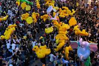 Pro-democracy protesters carry large inflatable ducks during an anti-government rally at Lat Phrao intersection in Bangkok