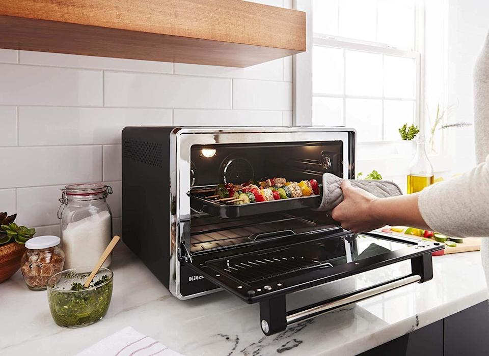 """<p><strong>KitchenAid</strong></p><p>amazon.com</p><p><a href=""""https://www.amazon.com/dp/B07VJJ2JDT?tag=syn-yahoo-20&ascsubtag=%5Bartid%7C10055.g.33523372%5Bsrc%7Cyahoo-us"""" rel=""""nofollow noopener"""" target=""""_blank"""" data-ylk=""""slk:BUY NOW"""" class=""""link rapid-noclick-resp"""">BUY NOW</a></p><p><em><strong>Originally: </strong>$279.99</em><strong><br></strong></p><p>Calling all space space dwellers: KitchenAid's countertop oven can toast, fry, roast, and bake your favorite dishes to perfection. Plus, it'll take minimal space into your already-tiny apartment. </p>"""