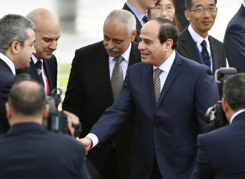 Egyptian President Abdel Fattah el-Sisi, center, arrives at Kansai International Airport in Izumisano, Osaka prefecture, western Japan, Thursday, June 27, 2019. Group of 20 leaders gather in Osaka on June 28 and 29 for their annual summit.(Nobuki Ito/Kyodo News via AP)