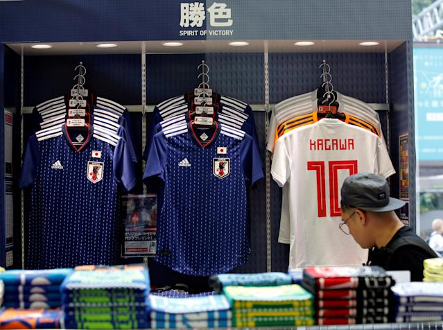 A customer looks at Japan's national soccer team's uniform at soccer shop KAMO in Tokyo, Japan May 17, 2018. REUTERS/Kim Kyung-Hoon