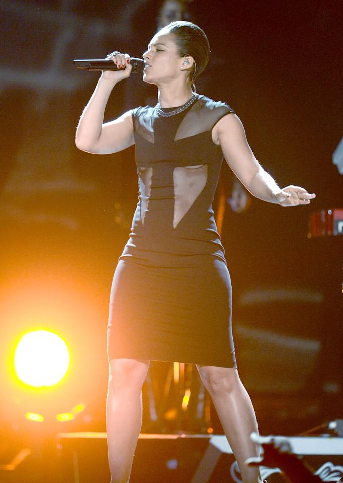 Alicia Keys opted to cross-cover her chest while she was performing but we can't help but notice the boob-squishing action of her dress as seen through the sheer.