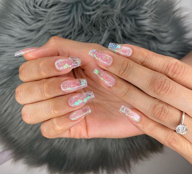 """<p>Another take on the holographic trend, these not quite see-through, millennial pink nails are a great way to do glitter.</p><p><a class=""""link rapid-noclick-resp"""" href=""""https://www.amazon.com/ILNP-Daydreamer-Flamingo-Holographic-Metallic/dp/B072MBMFXR/?tag=syn-yahoo-20&ascsubtag=%5Bartid%7C10055.g.29799716%5Bsrc%7Cyahoo-us"""" rel=""""nofollow noopener"""" target=""""_blank"""" data-ylk=""""slk:SHOP PINK HOLOGRAPHIC NAIL POLISH"""">SHOP PINK HOLOGRAPHIC NAIL POLISH</a></p><p><a href=""""https://www.instagram.com/p/B42u3MZHOWn/&hidecaption=true"""" rel=""""nofollow noopener"""" target=""""_blank"""" data-ylk=""""slk:See the original post on Instagram"""" class=""""link rapid-noclick-resp"""">See the original post on Instagram</a></p>"""