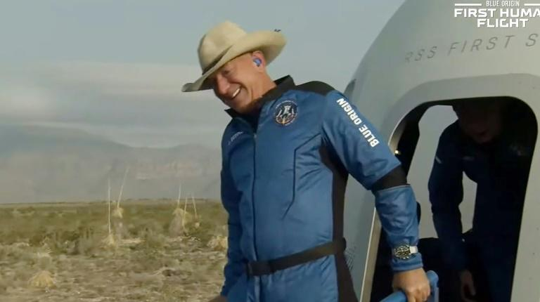 The world's richest man Jeff Bezos is seen here after returning to Earth aboard Blue Origin's reusable New Shepard capsule