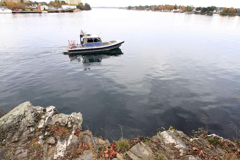 """The New Hampshire Marine Patrol continues to search the Piscataqua River near a cliff on Pierce Island for the body Elizabeth """"Lizzy"""" Marriott, a missing University of New Hampshire student on Monday, Oct. 15, 2012 in Portsmouth, N.H.  Seth Mazzaglia, a 29-year-old martial arts instructor was held without bail Monday on a charge of strangling or suffocating Marriott, who vanished a week ago. (AP Photo/Jim Cole)"""