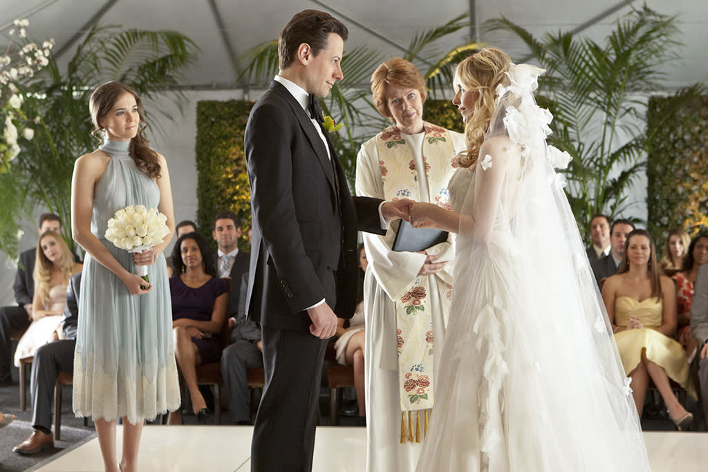 The wedding of Bridget Kelly (Sarah Michelle Gellar) and Andrew Martin (Ioan Gruffudd) on ?Ringer? (2012).
