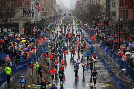 Runners approach the finish line on Boylston Street during the 122nd Boston Marathon in Boston, Massachusetts, U.S., April 16, 2018. REUTERS/Brian Snyder