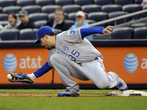 Kansas City Royals first baseman Eric Hosmer holds onto the ball to get New York Yankees' Derek Jeter on a groundout during the first inning of a baseball game, Monday, May 21, 2012, at Yankee Stadium in New York. (AP Photo/Bill Kostroun)
