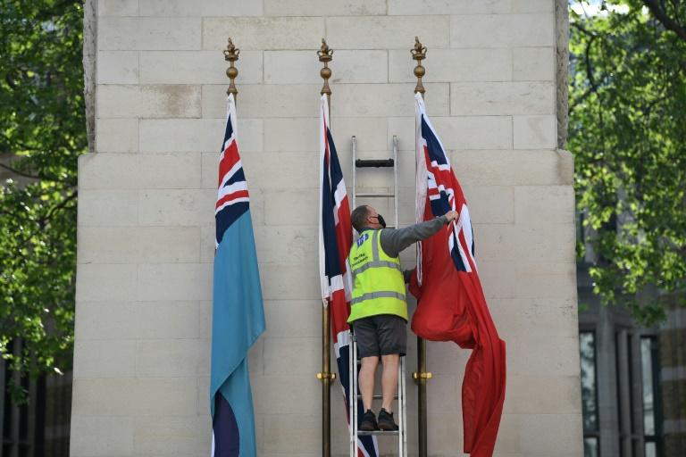 The flag of the Royal Air Force, Union Flag and the flag of Merchant Navy are raised on the Cenotaph war memorial in Whitehall, London (AFP Photo/DANIEL LEAL-OLIVAS)