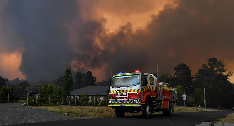 Rural Fire Service (RFS) crews prepare for the Green Wattle Creek Fire as it threatens homes in Yandeera.
