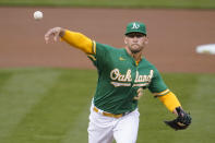 Oakland Athletics' James Kaprielian pitches against the San Francisco Giants during the first inning of a baseball game in Oakland, Calif., Friday, Aug. 20, 2021. (AP Photo/Jeff Chiu)