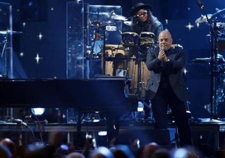 "Billy Joel performs during the ""12-12-12"" benefit concert for victims of Superstorm Sandy at Madison Square Garden in New York"