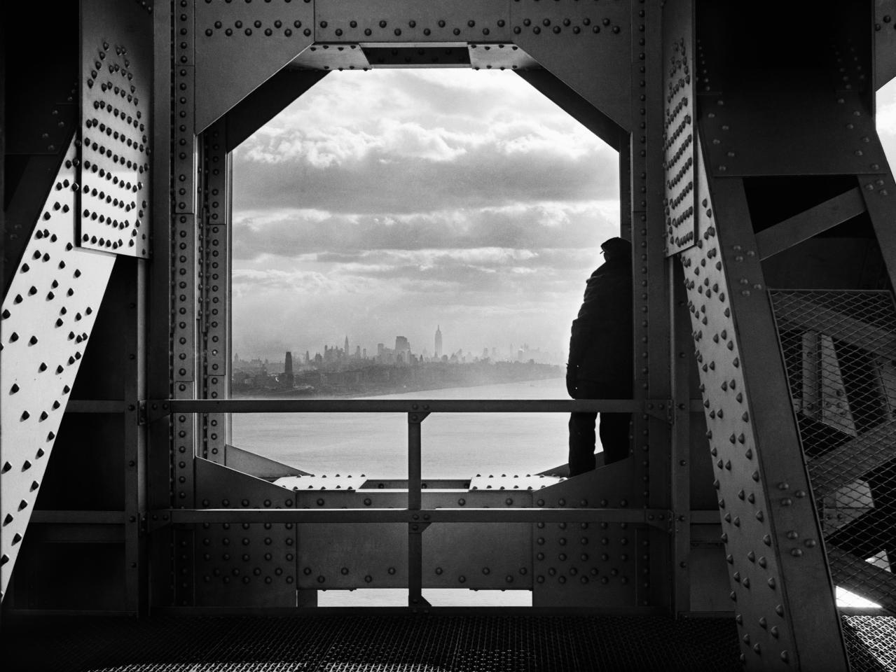 In this Dec. 22, 1936, Works Progress Administration photo provided by the New York City Municipal Archives, a man looks at the Hudson River from the New York tower of the George Washington Bridge. Over 870,000 photos from an archive that exceeds 2.2 million images have been scanned and made available online, for the first time giving a global audience a view of a rich collection that documents New York City life.  (AP Photo/New York City Municipal Archives, WPA Federal Writers' Project, Jack Rosenzwieg) MANDATORY