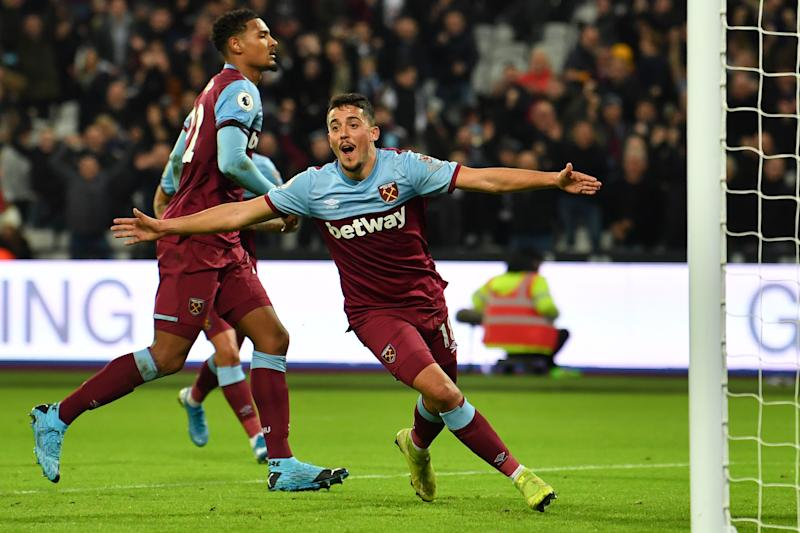 West Ham United's Spanish midfielder Pablo Fornals celebrates scoring their first goal to equalise 1-1 during the English Premier League football match between West Ham United and Leicester City at The London Stadium, in east London on December 28, 2019. (Photo by Ben STANSALL / AFP) / RESTRICTED TO EDITORIAL USE. No use with unauthorized audio, video, data, fixture lists, club/league logos or 'live' services. Online in-match use limited to 120 images. An additional 40 images may be used in extra time. No video emulation. Social media in-match use limited to 120 images. An additional 40 images may be used in extra time. No use in betting publications, games or single club/league/player publications. / (Photo by BEN STANSALL/AFP via Getty Images)