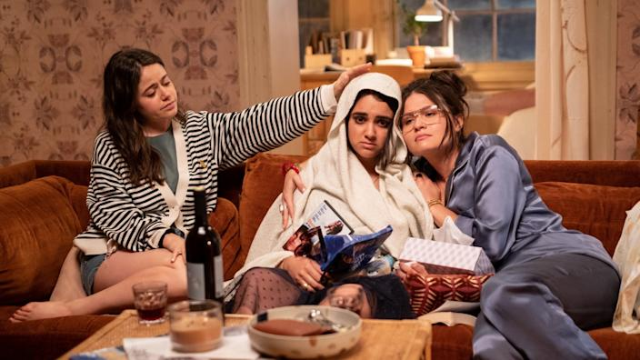"""Amanda (Molly Gordon), left, and Nadine (Phillipa Soo) console a freshly heartbroken Lucy (Geraldine Viswanathan) in """"The Broken Hearts Gallery."""" """"It was important to show that kind of female friendship onscreen, because those friendships are the ones that carry us through our twenties,"""" Krinsky said. <span class=""""copyright"""">(George Kraychyk / Columbia Tristar)</span>"""