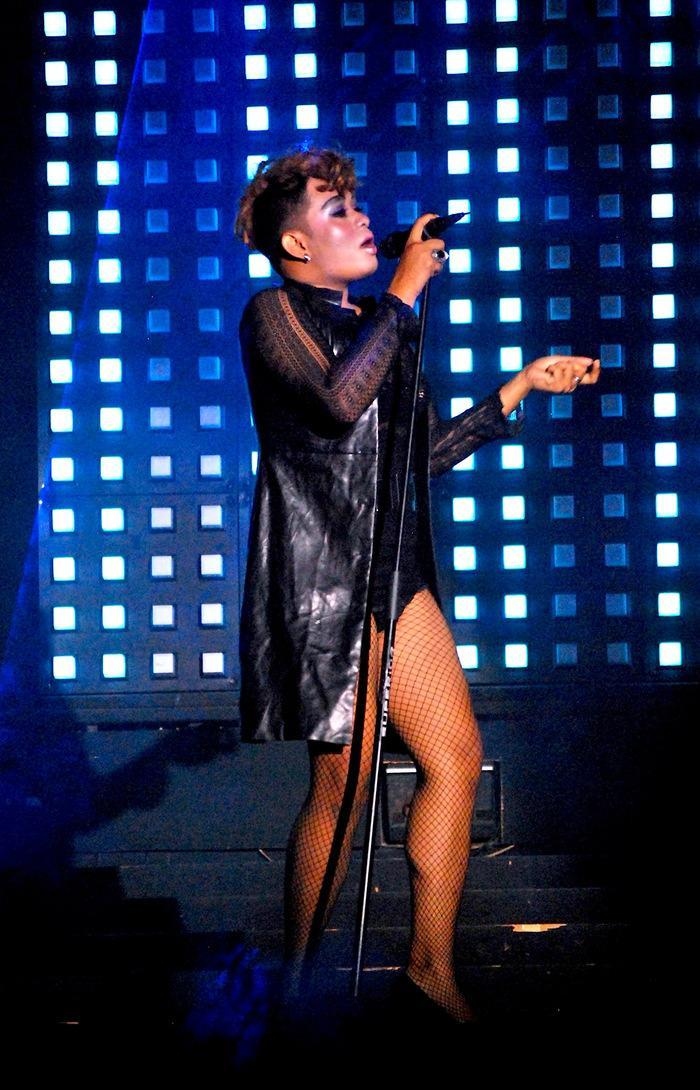 """Man on Fire: The Alicia Keys look-alike sings """"Girl on Fire"""" during a lip sync performance. It was the opening show of the cabaret. ("""