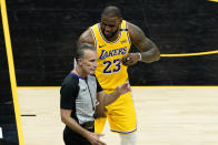 Los Angeles Lakers forward LeBron James (23) argues a call during the second half of Game 5 of an NBA basketball first-round playoff series against the Phoenix Suns, Tuesday, June 1, 2021, in Phoenix. (AP Photo/Matt York)