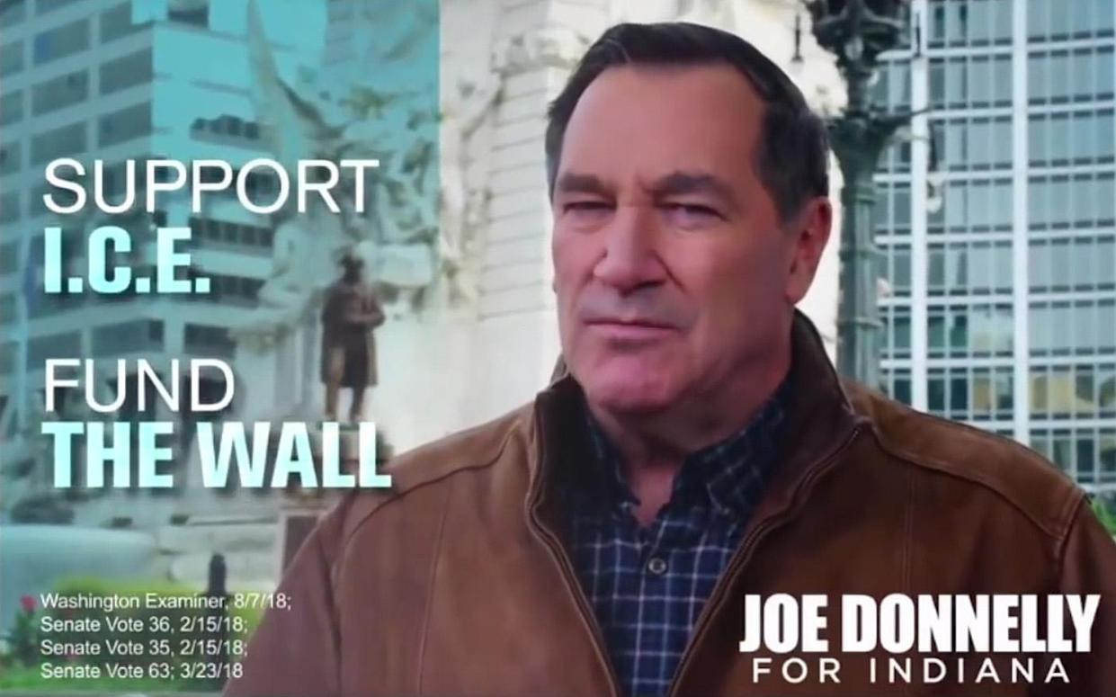 """A new ad in which Indiana's Democratic Sen. Joe Donnelly appears next to a graphic that says: """"Support I.C.E. Fund the wall."""" (Photo: YouTube)"""