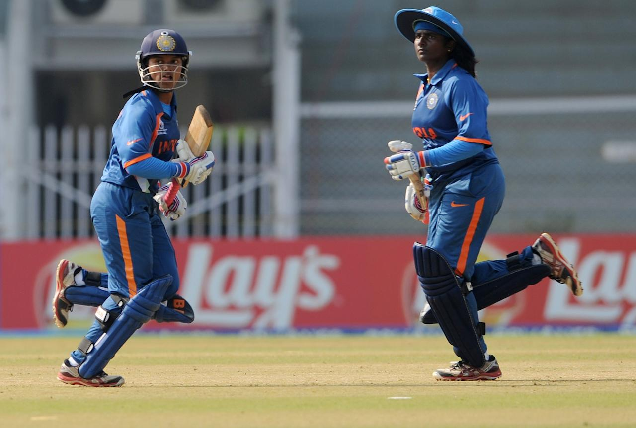 Indian cricketers Punam Raut (L) and Thirush Kamini (R) take a run during the inugural match of the ICC Women's World Cup 2013 between India and West Indies at the Cricket Club of India's Brabourne stadium in Mumbai on January 31, 2013. Teams from Australia, England, New Zealand, Pakistan, South Africa, Sri Lanka, West Indies join hosts India for the global event which is being played from 31 January to 17 February.  The women's World Cup opened in Mumbai with the cricketers hoping to put aside memories of the unsavoury build-up and gain their due recognition in a country where the men's game reigns supreme. AFP PHOTO/ Indranil MUKHERJEE        (Photo credit should read INDRANIL MUKHERJEE/AFP/Getty Images)