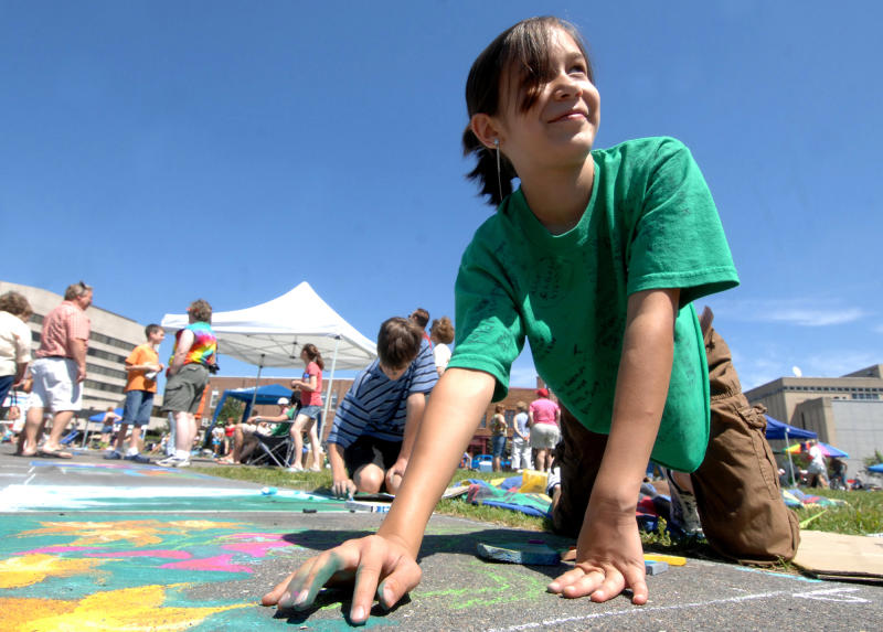 FILE - In this July 2007 file photo, Madeline Kara Neumann, of Weston, Wis., is shown working on chalk art last summer during downtown Wausau's Chalk Fest. Neumann died Sunday, March 23, 2008, after her parents prayed for healing rather than getting medical help for a treatable form of diabetes. On Wednesday, July 3, 2013, the Wisconsin Supreme Court ruled that her parents were properly convicted of homicide. (AP Photo/Wausau Daily Herald, Butch McCartney, File)