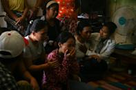 Relatives of slain Myanmar protester Chit Min Thu react after learning that security forces shot him in the head while demonstrating against the military regime in Yangon