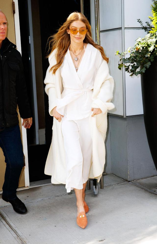 <p>Gigi Hadid steps out in New York City wearing a silk white suit by Zeynep Arçay and the EyeLove mules from Hadid's new collection with Stuart Weitzman. (Photo: Getty Images) </p>