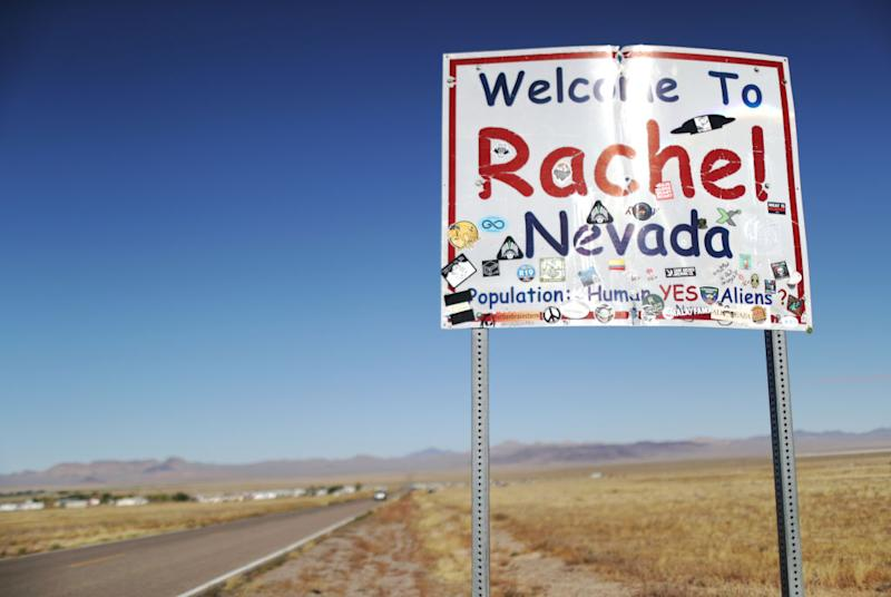 A town sign is posted, mentioning aliens, during the 'Storm Area 51' spinoff event 'Alienstock' on September 21, 2019 in Rachel, Nevada. | Mario Tama—Getty Images