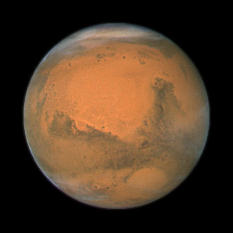 FILE - In this file image provided by NASA's Hubble Space Telescope a close-up of the red planet Mars is shown. Two scientists are proposing we send volunteers to Mars and leave them there. They say the mission would mark the beginning of long-term human colonization of Mars, with numerous follow-up trips. The colleagues contend one-way missions could happen a lot quicker and cheaper, and it is essential to begin colonizing another planet as a hedge against a catastrophe that makes Earth uninhabitable. (AP Photo/NASA, File)